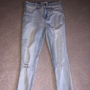 Light blue jeans with small rips